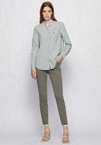 BOSS - Slim fit jeans - dark green - 1