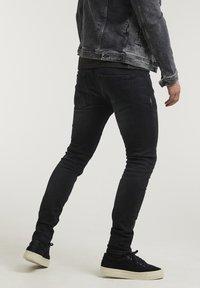 CHASIN' - EGO  - Slim fit jeans - black - 1