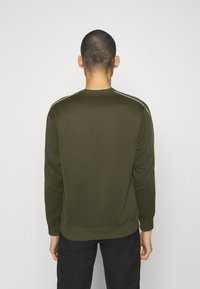 Nike Sportswear - REPEAT CREW - Long sleeved top - cargo khaki - 2