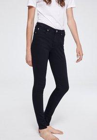 ARMEDANGELS - TILLY - Slim fit jeans - rinse black - 0