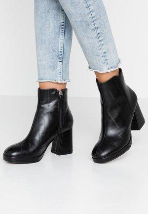 EDDIE PLATFORM BOOT - Platform ankle boots - black