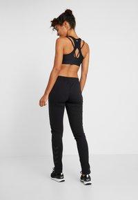 Hummel - HMLNICA - Træningsbukser - black - 2