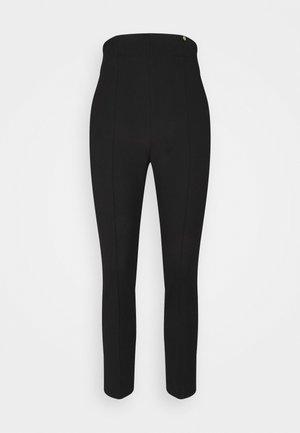 PANT SKINNY - Trousers - nero