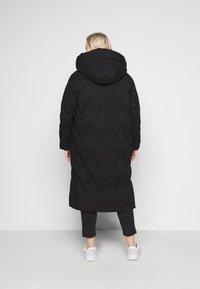 Vero Moda Curve - VMPUFFY LONG JACKET - Down coat - black - 2