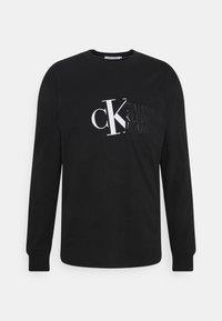 Calvin Klein Jeans - HYBRID POCKET TEE UNISEX - Print T-shirt - black - 0