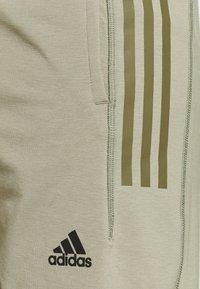 adidas Performance - MENS YOGA PANT - Tracksuit bottoms - orbit green - 4