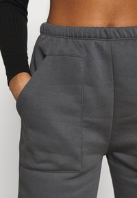 Nly by Nelly - COZY POCKET PANTS - Tracksuit bottoms - off-black - 5