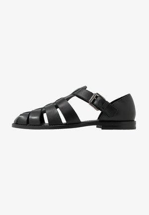 KRISTOF - Loaferit/pistokkaat - black