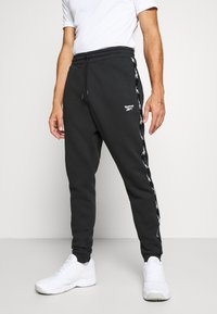 Reebok - TAPE JOGGER - Tracksuit bottoms - black - 0