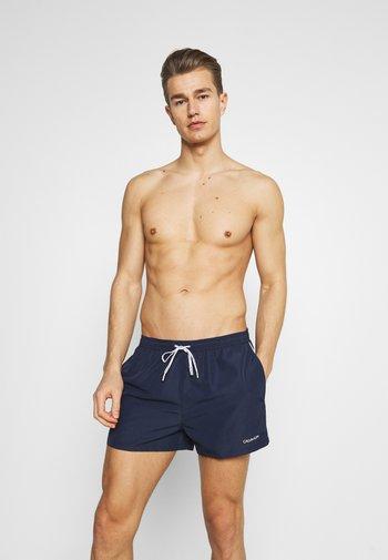 LOGO TIES RUNNER PACKABLE - Swimming shorts - blue