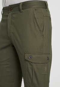 Columbia - DESCHUTES RIVER CARGO PANT - Trousers - peatmoss - 4