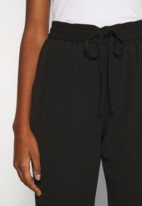 Vero Moda - VMSAGA STRING PANT - Trousers - black - 3