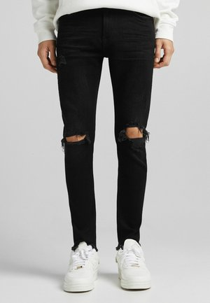 RIPPED - Slim fit jeans - black