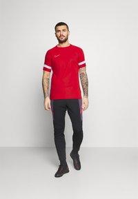 Nike Performance - Triko spotiskem - university red/white - 1