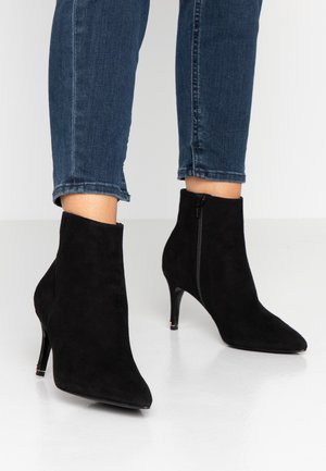 OBSESSED - Ankle boots - black