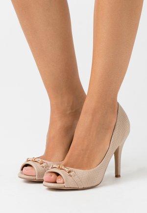 CRAVE - Peeptoe heels - neutral