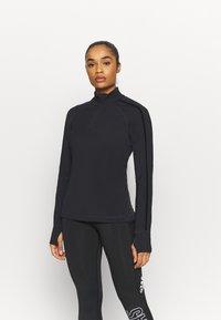Sweaty Betty - THERMODYNAMIC HALF ZIP REFLECTIVE - Fleece jumper - black - 0