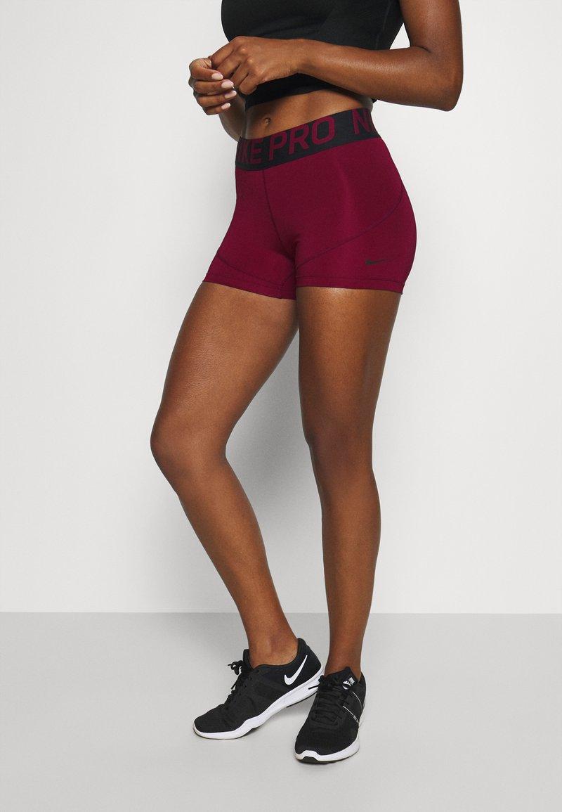 Nike Performance - Tights - dark beetroot/black