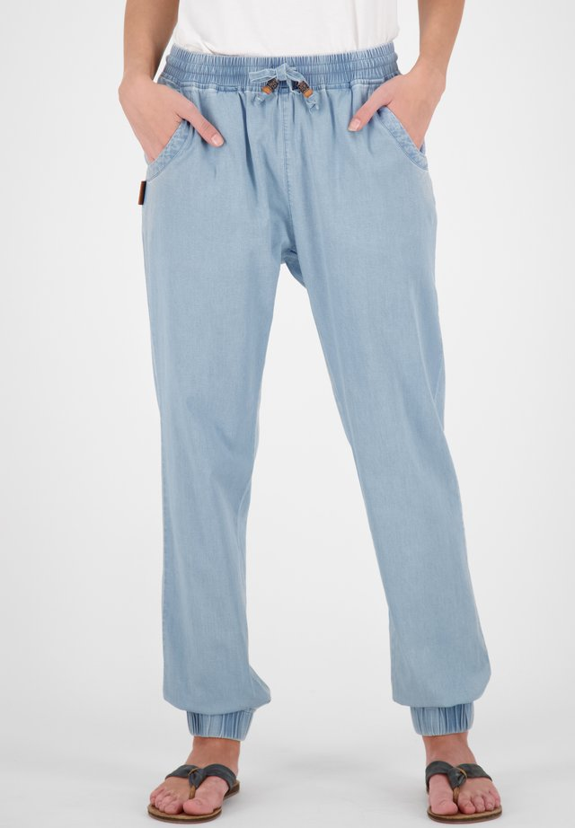 ALICIAAK - Tracksuit bottoms - light denim