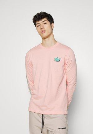 Långärmad tröja - glow pink