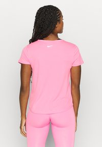 Nike Performance - RUN - T-Shirt print - pink glow/white - 2