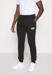 Jack & Jones - JJIGORDON  - Pantaloni sportivi - black - 2