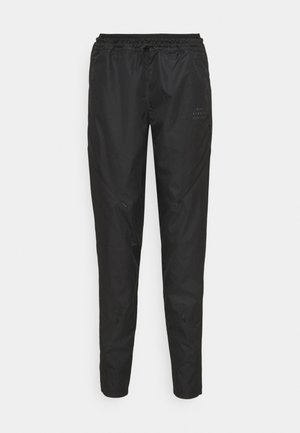 RUN PANT - Verryttelyhousut - black/gold