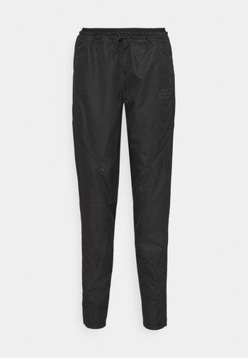 RUN PANT - Pantalones deportivos - black/gold