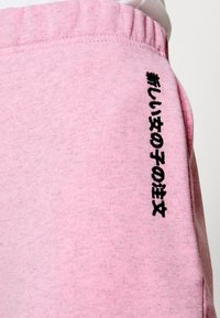 NEW girl ORDER - EMBROIDERED TEXT JOGGERS - Tracksuit bottoms - pink - 4