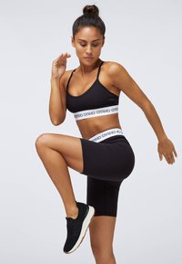 OYSHO - Sports shorts - black - 1
