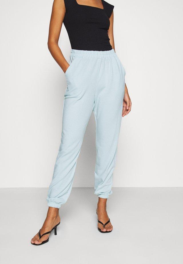BASIC - Spodnie treningowe - light blue