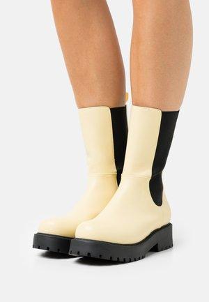 MONA BOOT VEGAN - Platform boots - yellow