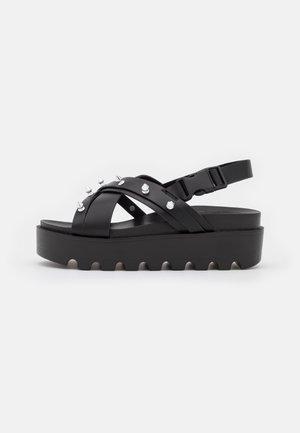 VEGAN PILUM SPIKED - Platform sandals - black