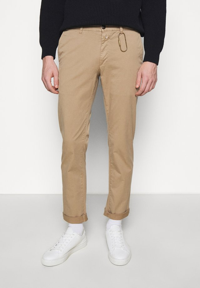 CLIFTON  - Trousers - beige