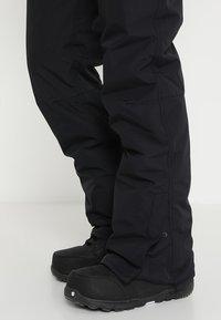 Brunotti - FOOTSTRAP MEN SNOWPANTS - Snow pants - black - 6