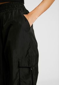 Tiger Mist - FLOSS PANT - Trousers - black - 3