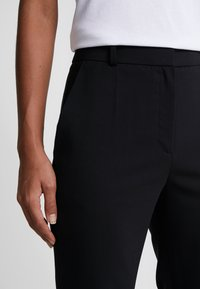 HUGO - THE REGULAR TROUSERS - Trousers - black - 4
