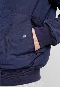 Tommy Jeans - TECH JACKET - Winter jacket - black iris - 6