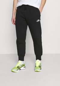 The North Face - JOGGER - Tracksuit bottoms - black - 0