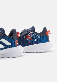 adidas Performance - TENSAUR RUN UNISEX - Neutral running shoes - legend ink/footwear white/blue - 5