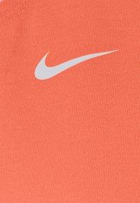 Nike Performance - DRY ELASTIKA TANK - Sportshirt - bright mango/white - 5