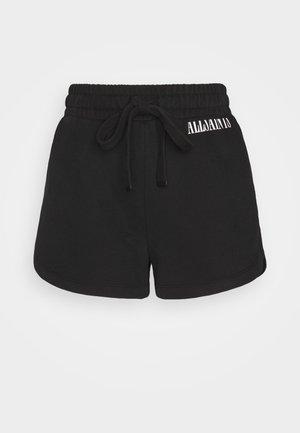 LILA - Shorts - black