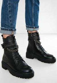 Inuovo - Cowboy/biker ankle boot - black blk - 0