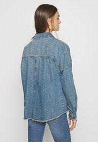 Vero Moda - VMMINA LOOSE - Button-down blouse - medium blue denim - 2