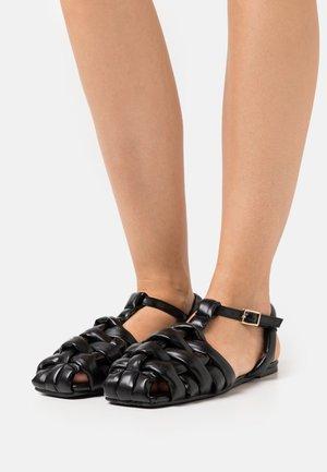 ELECTAA - Sandaalit nilkkaremmillä - black