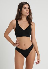 Calvin Klein Underwear - LINED BRALETTE - Triangle bra - black - 1