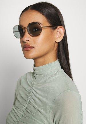 Sluneční brýle - shiny gold-coloured