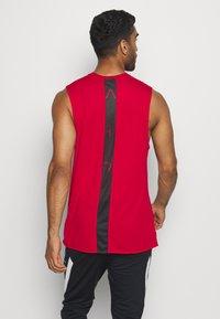 Jordan - AIR TOP - Funkční triko - gym red - 2