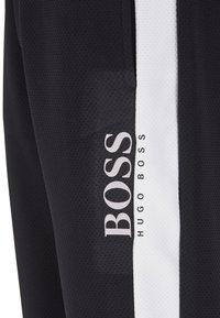 BOSS - Pantalon de survêtement - black - 5