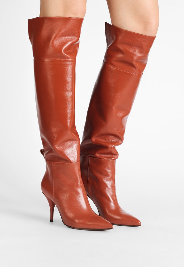 High heeled boots - russet